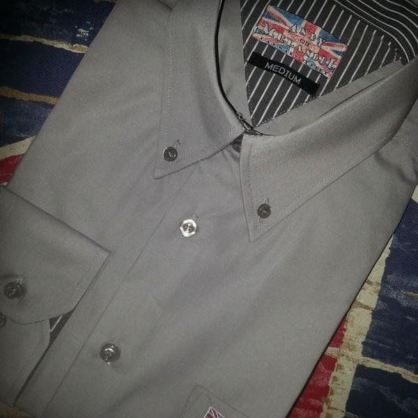 Grey shirt with grey stripe trim